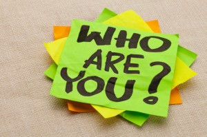 a post-it note that reads: Who Are You?