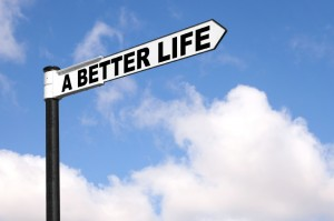 A Better Life sign with sky in the background